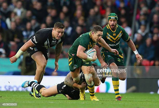 Billy Slater of Australia is tackled by Sonny Bill Williams of New Zealand during the Rugby League World Cup Final between New Zealand and Australia...