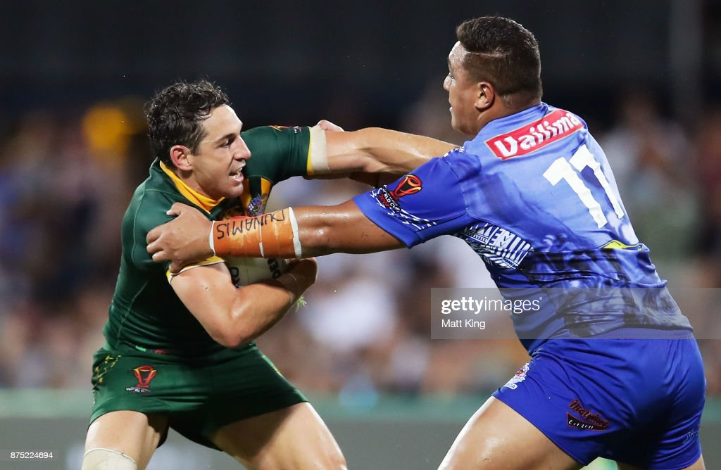 Billy Slater of Australia puts a fend on Josh Papali of Samoa during the 2017 Rugby League World Cup Quarter Final match between Australia and Samoa at Darwin Stadium on November 17, 2017 in Darwin, Australia.