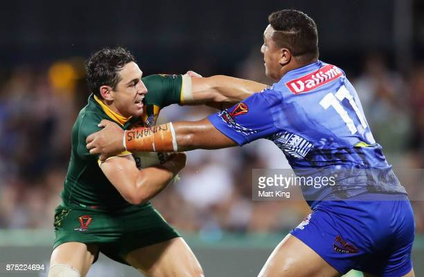 Billy Slater of Australia puts a fend on Josh Papali of Samoa during the 2017 Rugby League World Cup Quarter Final match between Australia and Samoa...