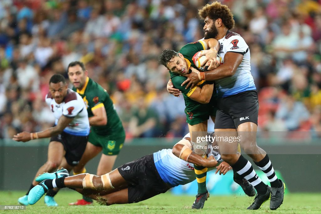 Billy Slater of Austrlia is tackled during the 2017 Rugby League World Cup Semi Final match between the Australian Kangaroos and Fiji at Suncorp Stadium on November 24, 2017 in Brisbane, Australia.