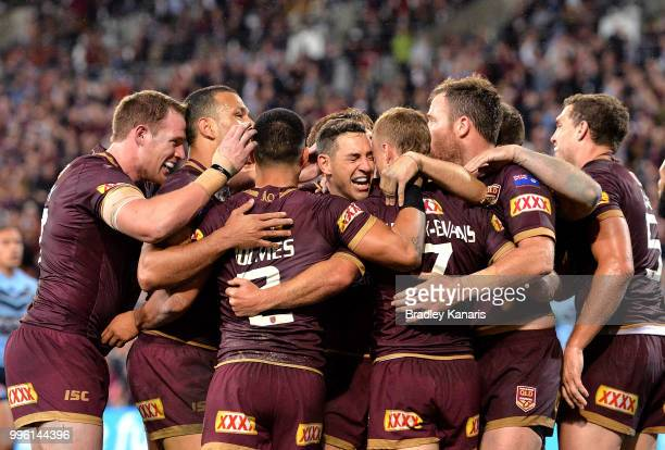 Billy Slater of Queensland and team mates are seen celebrating a try by team mate Daly CherryEvans during game three of the State of Origin series...