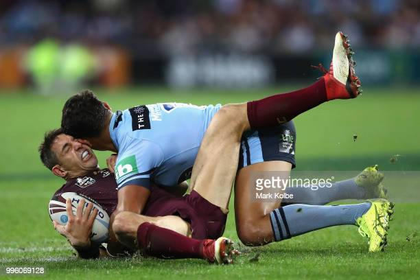 Billy Slater of Queensland is tackled by Latrell Mitchell of the Blues during game three of the State of Origin series between the Queensland Maroons...
