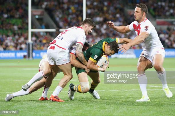 Billy Slater of the Kangaroos gets tackled by John Bateman of England and Sam Burgess during the 2017 Rugby League World Cup match between the...