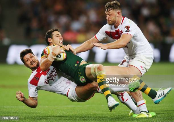 Billy Slater of the Kangaroos is tackled by Gareth Widdop of England during the 2017 Rugby League World Cup match between the Australian Kangaroos...