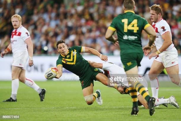 Billy Slater of the Kangaroos passes the ball to Wade Graham of the Kangaroos during the 2017 Rugby League World Cup match between the Australian...