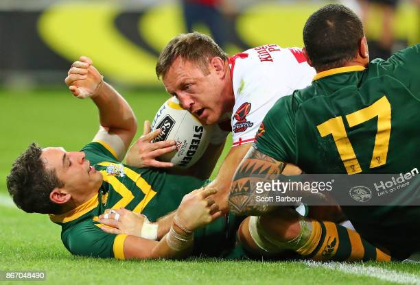 Billy Slater of the Kangaroos performs a try saving tackle as James Roby of England attempts to score a try during the 2017 Rugby League World Cup...