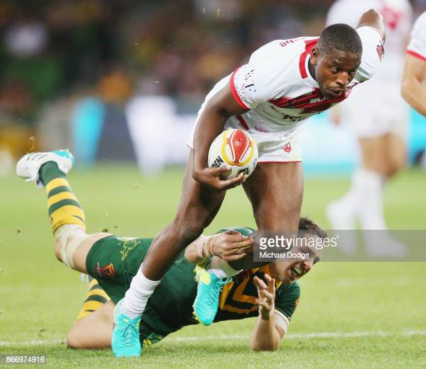 Billy Slater of the Kangaroos tackles Jermaine McGillvary of England during the 2017 Rugby League World Cup match between the Australian Kangaroos...