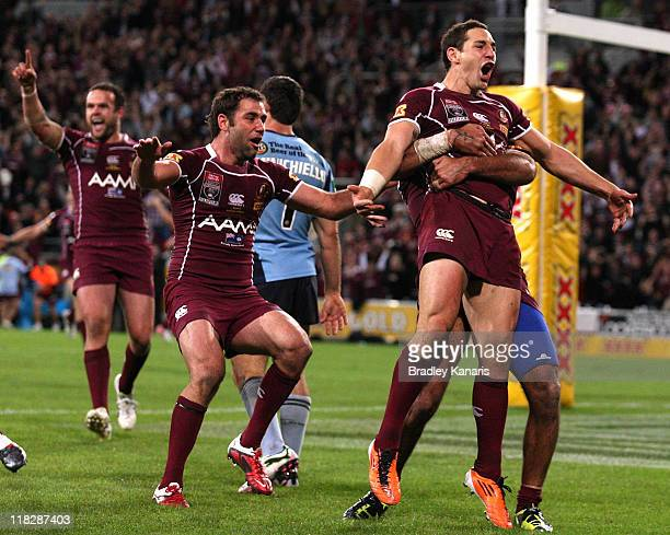 Billy Slater of the Maroons celebrates after scoring a try during game three of the ARL State of Origin series between the Queensland Maroons and the...