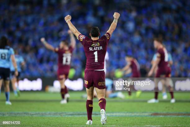 Billy Slater of the Maroons celebrates victory at the end of game two of the State Of Origin series between the New South Wales Blues and the...