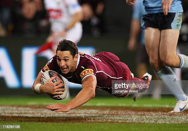 Billy Slater of the Maroons dives to score a try during game three of the ARL State of Origin series between the Queensland Maroons and the New South...