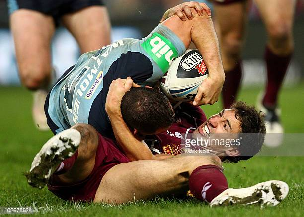 Billy Slater of the Maroons holds Anthony Watmough of the Blues up over the line to prevent a try during game three of the ARL State of Origin series...