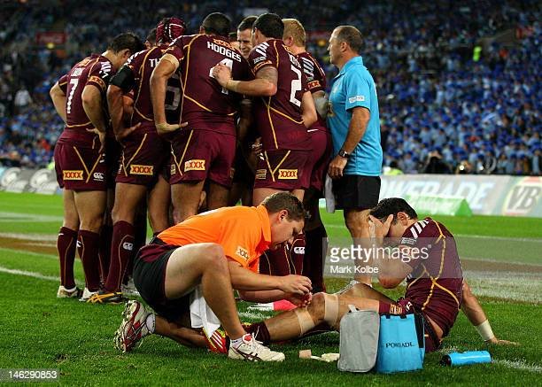 Billy Slater of the Maroons is attended to by the trainer during game two of the ARL State of Origin series between the New South Wales Blues and the...