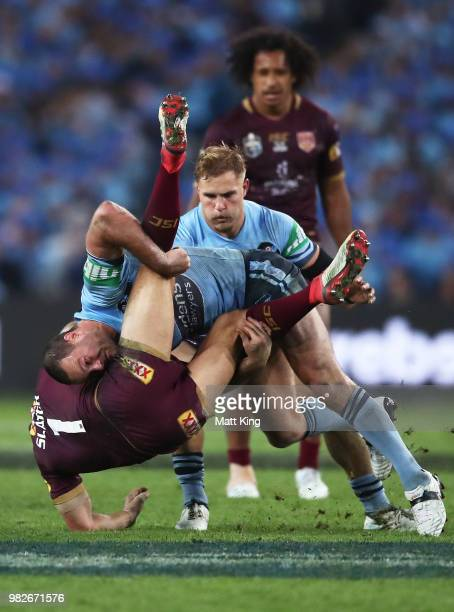 Billy Slater of the Maroons is tackled by Boyd Cordner of the Blues during game two of the State of Origin series between the New South Wales Blues...