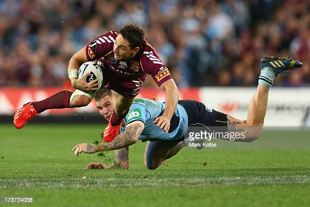 Billy Slater of the Maroons is tackled by Josh Dugan of the Blues during game three of the ARL State of Origin series between the New South Wales...