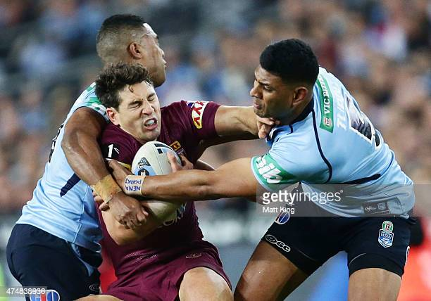 Billy Slater of the Maroons is tackled during game one of the State of Origin series between the New South Wales Blues and the Queensland Maroons at...
