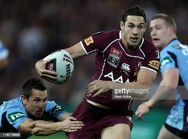 Billy Slater of the Maroons makes a break during game three of the ARL State of Origin series between the Queensland Maroons and the New South Wales...