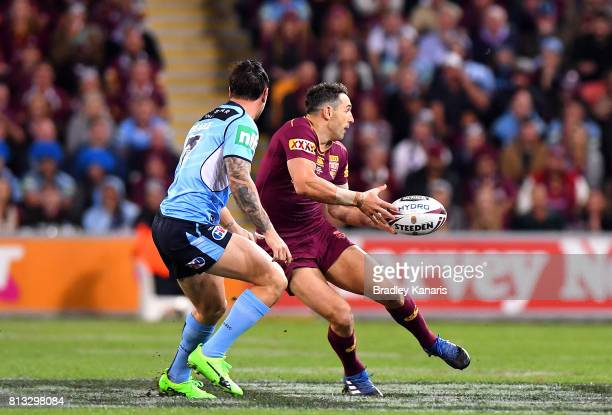 Billy Slater of the Maroons passes the ball during game three of the State Of Origin series between the Queensland Maroons and the New South Wales...