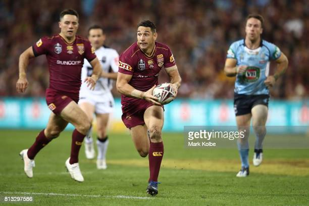 Billy Slater of the Maroons runs the ball during game three of the State Of Origin series between the Queensland Maroons and the New South Wales...