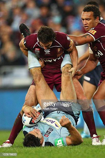 Billy Slater of the Maroons tackles Trent Barrett of the Blues during game three of the ARL State of Origin series between the New South Wales Blues...