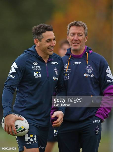 Billy Slater of the Melbourne Storm and Storm coach Craig Bellamy talk during a Melbourne Storm NRL media session at Gosch's Paddock on May 16 2018...