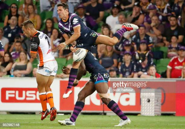 Billy Slater of the Melbourne Storm drops a high ball as he collides with Suliasi Vunivalu of the Melbourne Storm during the round two NRL match...