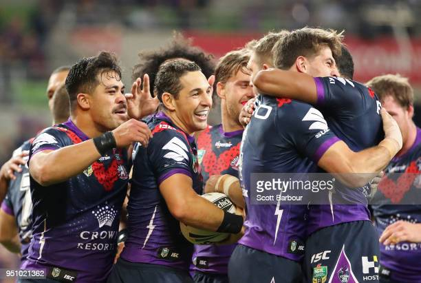 Billy Slater of the Melbourne Storm is congratulated by his teammates after scoring a try during the round eight NRL match between the Melbourne...