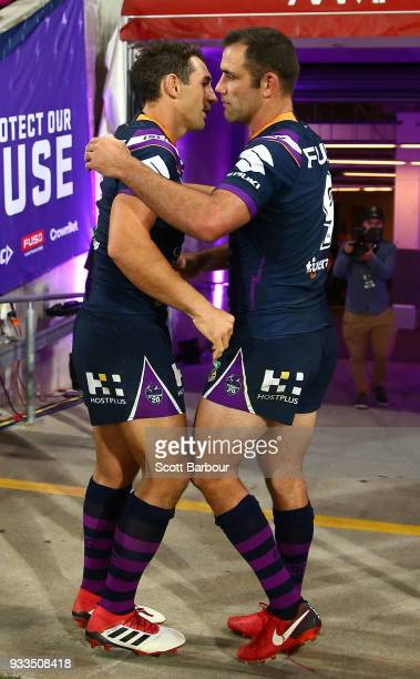 Billy Slater of the Melbourne Storm is embraced by Cameron Smith of the Melbourne Storm as he leaves the field after playing his 300th game during...