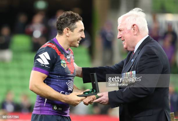 Billy Slater of the Melbourne Storm is presented with the Anzac Medal for best on ground after the round eight NRL match between the Melbourne Storm...