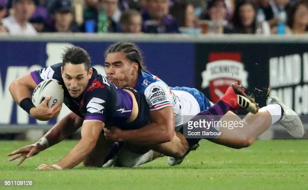 Billy Slater of the Melbourne Storm is tackled during the round eight NRL match between the Melbourne Storm and New Zealand Warriors at AAMI Park on...