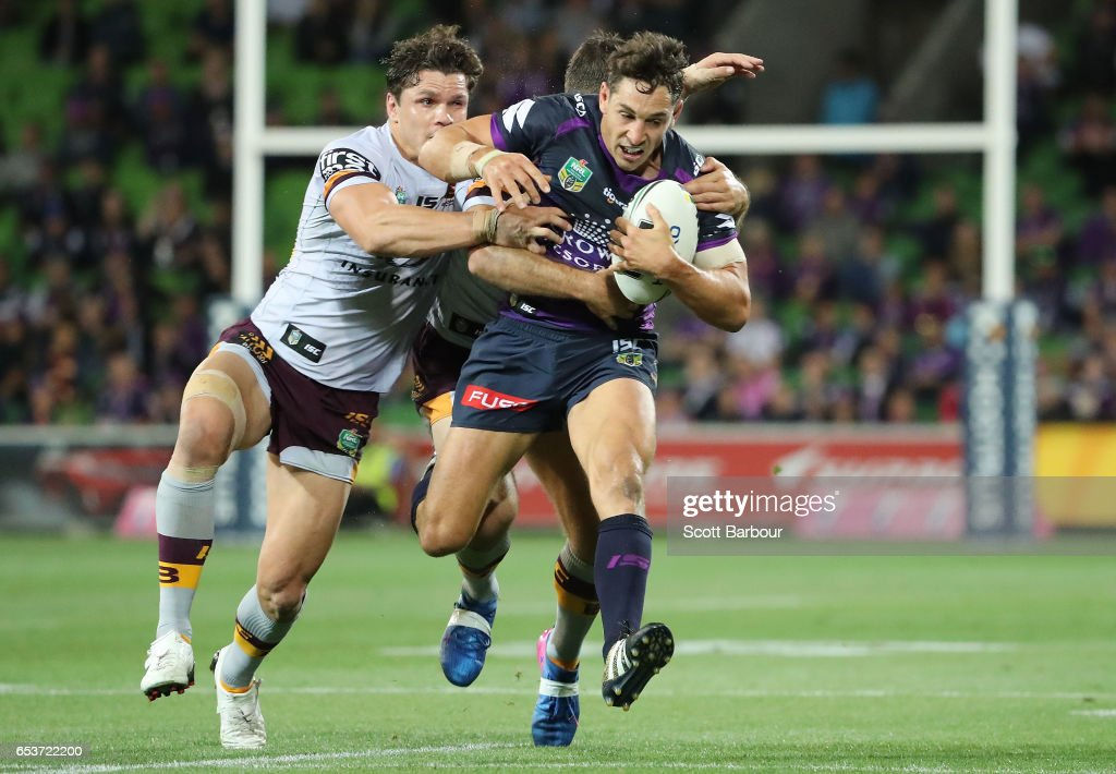 Billy Slater of the Melbourne Storm is tackled during the round three NRL match between the Melbourne Storm and the Brisbane Broncos at AAMI Park on March 16, 2017 in Melbourne, Australia.