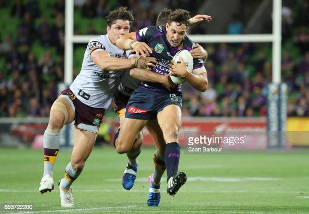 Billy Slater of the Melbourne Storm is tackled during the round three NRL match between the Melbourne Storm and the Brisbane Broncos at AAMI Park on...