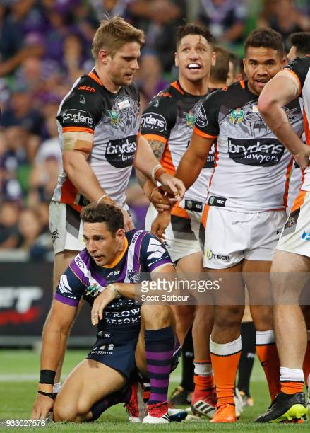 Billy Slater of the Melbourne Storm looks dejected as the Tigers celebrates winning the round two NRL match between the Melbourne Storm and the Wests...