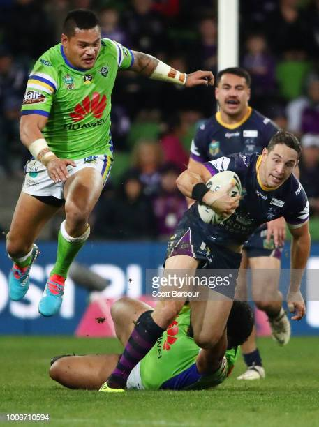 Billy Slater of the Melbourne Storm runs with the ball during the round 20 NRL match between the Melbourne Storm and the Canberra Raiders at AAMI...
