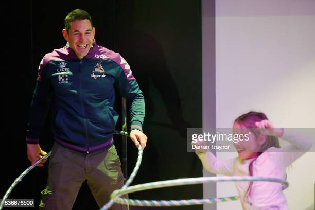Billy Slater of the Melbourne Storm takes part in a hula hoop contest during a Melbourne Storm NRL media opportunity at the Royal Children's Hospital...