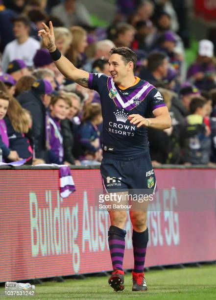 Billy Slater of the Melbourne Storm waves goodbye to supporters in the crowd after winning the NRL Preliminary Final match between the Melbourne...