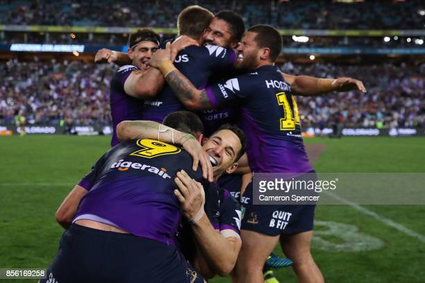 Billy Slater of the Storm and Cameron Smith of the Storm celebrate winning the 2017 NRL Grand Final match between the Melbourne Storm and the North...