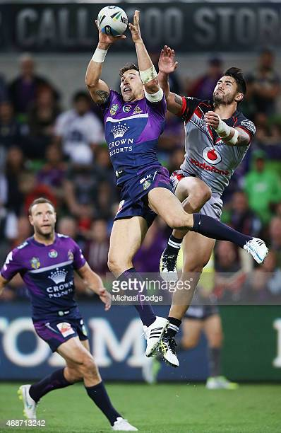 Billy Slater of the Storm and Chad Townsend of the Warriors compete for the ball during the round five NRL match between the Melbourne Storm and the...