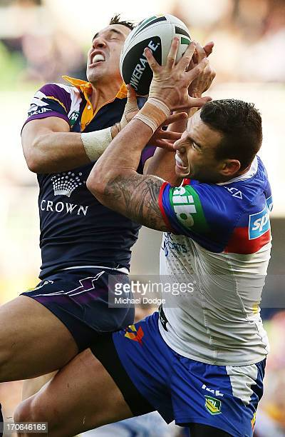 Billy Slater of the Storm and Darius Boyd of the Knights contest for the ball during the round 14 NRL match between the Melbourne Storm and the...