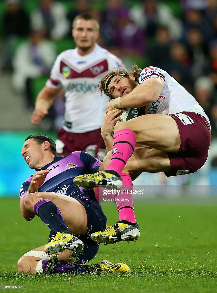 Billy Slater of the Storm and David Williams of the Sea Eagles compete for the ball during the round 10 NRL match between the Melbourne Storm and the Manly Sea Eagles at AAMI Park on May 20, 2013 in Melbourne, Australia.