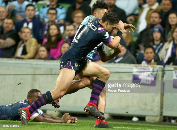 Billy Slater of the Storm applies a shoulder charge on Sosaia Feki of the Sharks to stop him from scoring a try during the NRL Preliminary Final...
