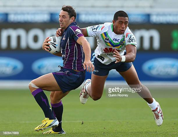 Billy Slater of the Storm avoids a tackle during the NRL trial match between the Melbourne Storm and the Canberra Raiders at Simonds Stadium on...