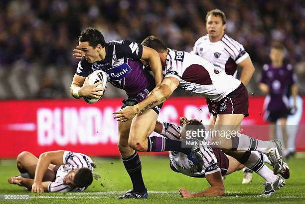 Billy Slater of the Storm breaks the Sea Eagkes' line during the first NRL qualifying final match between the Melbourne Storm and the Manly Warringah...