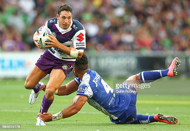 Billy Slater of the Storm breaks through a tackle by Tim Lafia of the Bulldogs during the NRL Trial Match between the Melbourne Storm and Canterbury...