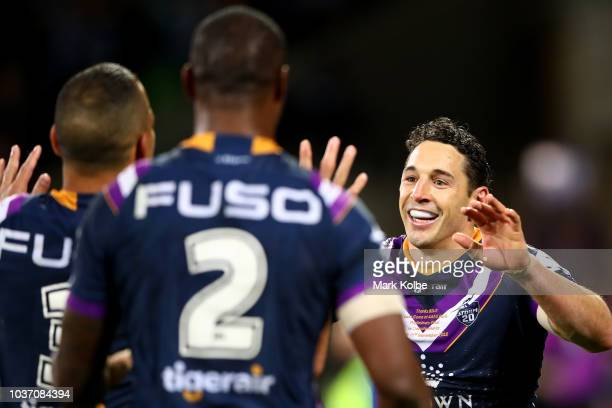 Billy Slater of the Storm celebrates scoring a try during the NRL Preliminary Final match between the Melbourne Storm and the Cronulla Sharks at AAMI...