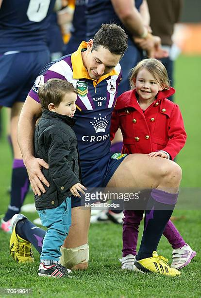 Billy Slater of the Storm celebrates the win with his children Jake Slater and Tyla Slater during the round 14 NRL match between the Melbourne Storm...