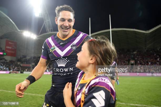 Billy Slater of the Storm celebrates with his daughter after winning the NRL Preliminary Final match between the Melbourne Storm and the Cronulla...