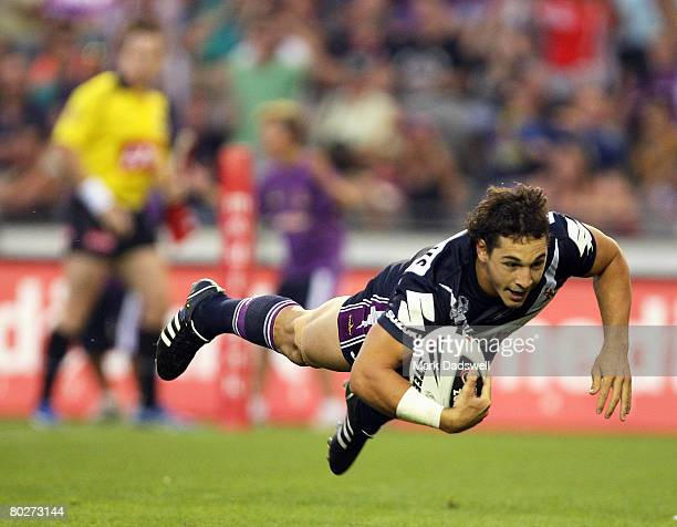 Billy Slater of the Storm crosses for the first try of the match during the round one NRL match between the Melbourne Storm and the Warriors at the...