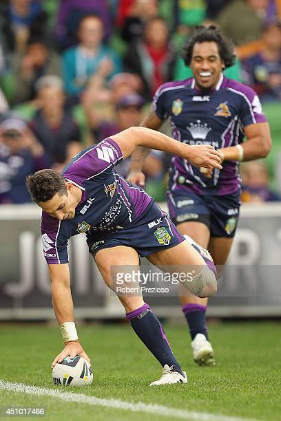 Billy Slater of the Storm crosses the line to score a try during the round 15 NRL match between the Melbourne Storm and the Parramatta Eels at AAMI...
