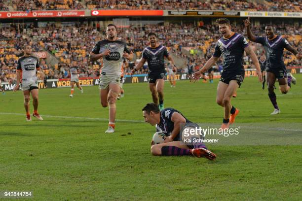 Billy Slater of the Storm dives over to score a try during the round five NRL match between the Wests Tigers and the Melbourne Storm at Mt Smart...