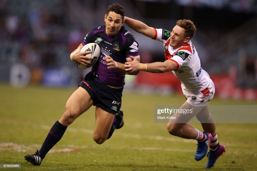 Billy Slater of the Storm evades the tackle of Kurt Mann of the Dragons during the round nine NRL match between the St George Illawarra Dragons and the Melbourne Storm at WIN Stadium on April 30, 2017 in Wollongong, Australia.